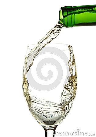 White wine pouring into glass