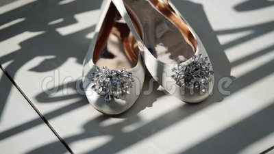 White woman`s bridal shoes. At balcony stock footage