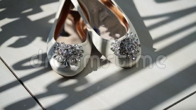 White woman`s bridal shoes. At balcony stock video footage