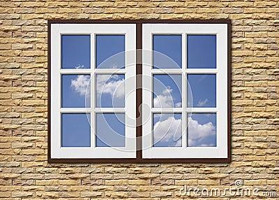 White wood window on stone walls