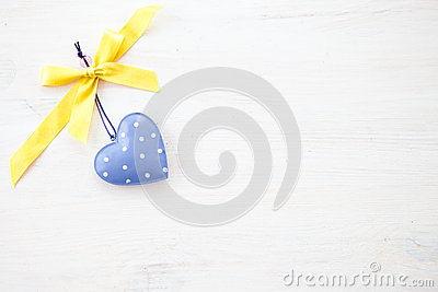 White wooden background with heart