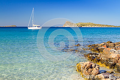 White yacht on the idyllic beach lagoon of Crete