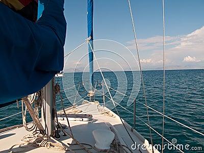 White yacht sailing on calm sea