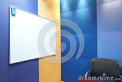 Whiteboard against blue wall