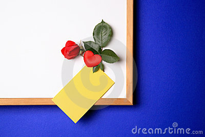 Whiteboard with yellow note