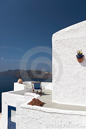 Whitewashed building and the island
