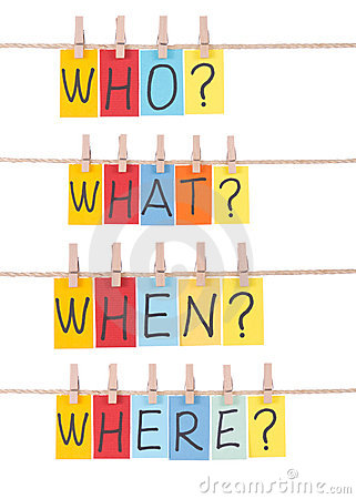 Who, what, when, where, colorful words hang on rope by wooden peg.