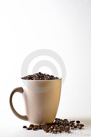 Free Whole Bean Coffee In Mug Isolated On White Stock Photos - 5486783