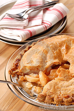 Whole deep dish apple pie with a flaky crust