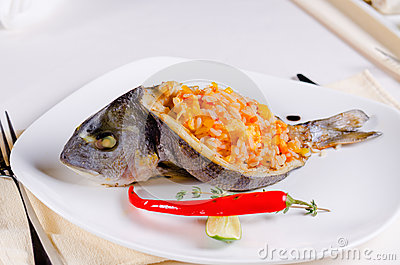 whole grilled fish stuffed with savory spicy rice and served with lime ...