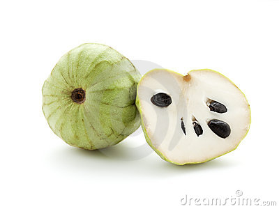 Whole and half Cherimoya fruit
