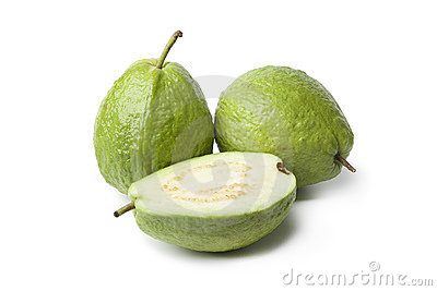 Whole and half fresh guava fruit