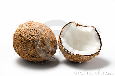 Whole and opened coconuts isolated