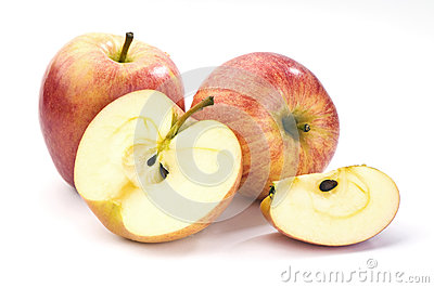 Whole and sliced red apples