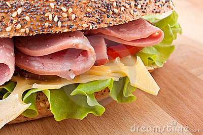 Whole wheat sandwich with lettuce, tomatoes, ham