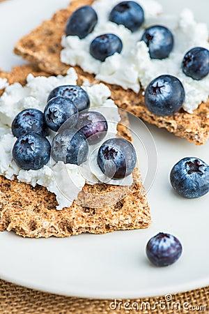 Free Wholegrain Rye Crispbread Crackers With Blueberries Stock Photos - 87682393