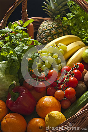 Wicker basket with fruit and vegetables