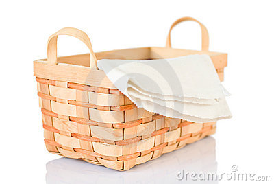 Wicker basket and napkin on white