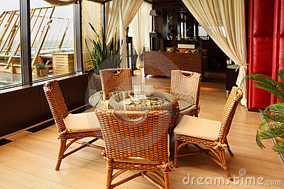 Wicker chairs and table in restaurant