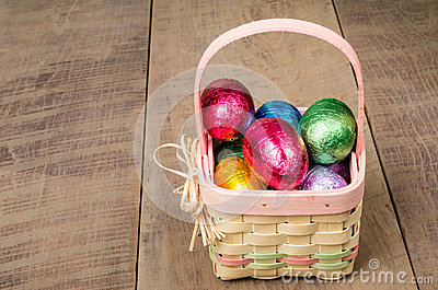 Wicker Easter basket with foil eggs