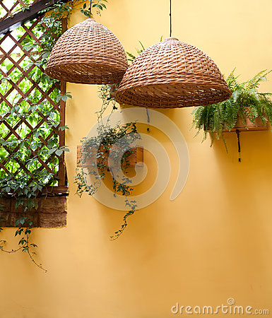 Free Wicker Lamps Shade Against A Background Of Yellow Wall Royalty Free Stock Image - 60636696