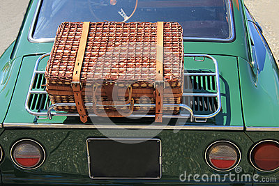 Wicker luggage on a classic car