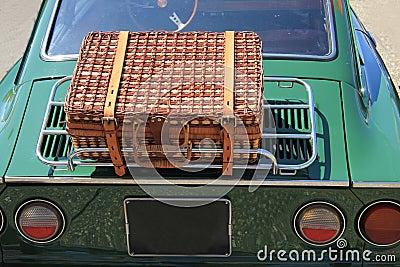 Wicker luggage on a classic car
