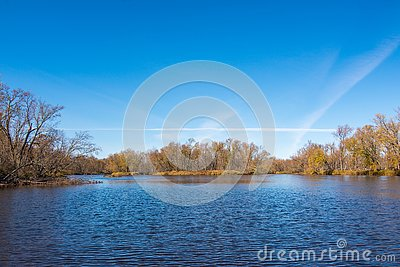 Wide angle landscape of an island in the vast St. Croix River with Wisconsin on the left shoreline and Minnesota on the right shor Stock Photo