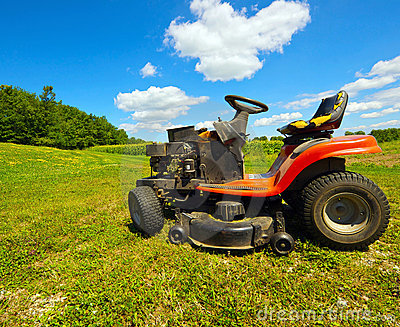 Wide angle mower on a farm.