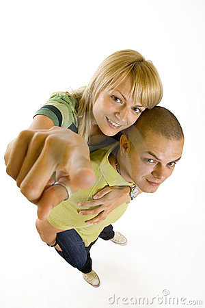 Wide angle picture of a young couple pointing