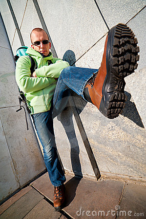 Wide angle urban portrait of a stylish man