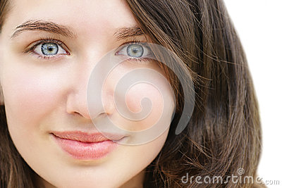Wide eyed young woman