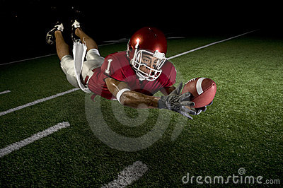 Wide Receiver Making a Diving Catch