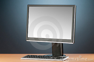 Wide screen computer monitor against  background