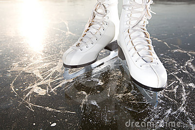Wide skates on ice with sun