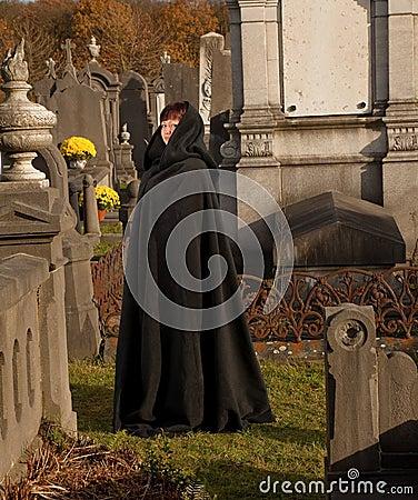 Widow in black cape