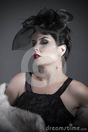 Widow on gray background, beautiful woman