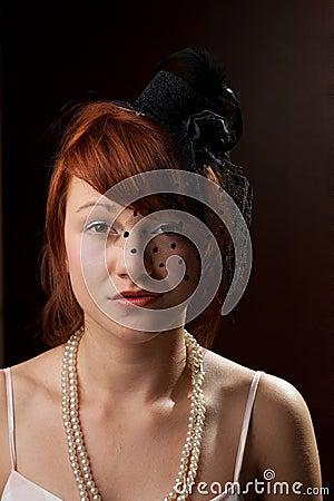 Widow redhead on brown background