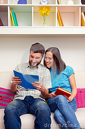 Wife and husband reading the book