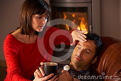 Wife Nursing Sick Husband With Cold