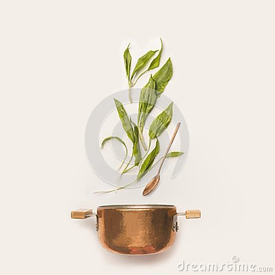 Free Wild Garlic Leaves And Cooking Pot With Spoon On White Background. Royalty Free Stock Image - 113926786