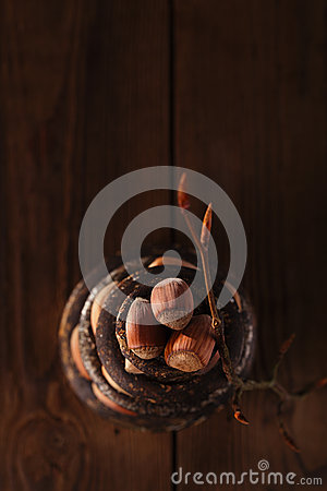 Wild hazelnut in iron bowls stacked on wooden table