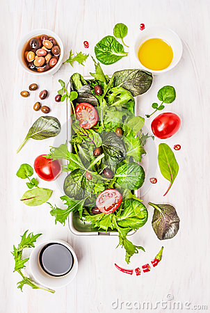 Free Wild Herbs Salad With Tomatoes,olives,oil And Vinegar On White Wooden Background Royalty Free Stock Image - 47080866