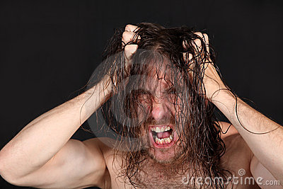 Wild man pulling long hair
