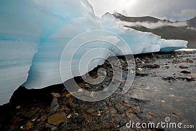 Wild Russia landscape. Ice glacier blocks,river.