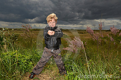 Young Boy standing on waste land
