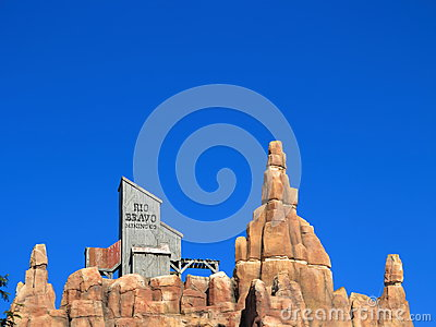 Wild west mountain top setting at rich blue sky Editorial Image