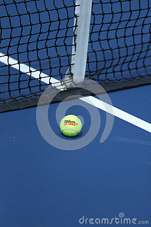 Wilson tennis ball on tennis court at Arthur Ashe Stadium Editorial Stock Photo