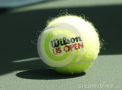 Wilson tennis ball on tennis court at Arthur Ashe Stadium Editorial Stock Image