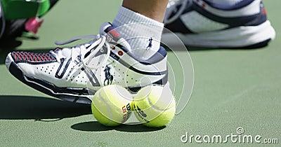 Wilson tennis balls on tennis court at Arthur Ashe Stadium during US Open 2013 Editorial Photography